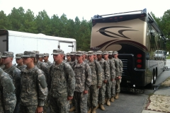 """Soldiers lined up behind """"Miss Vicky"""""""
